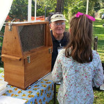 Leroy Cronkhite Sr. sharing and observation hive at the Farmington Fair